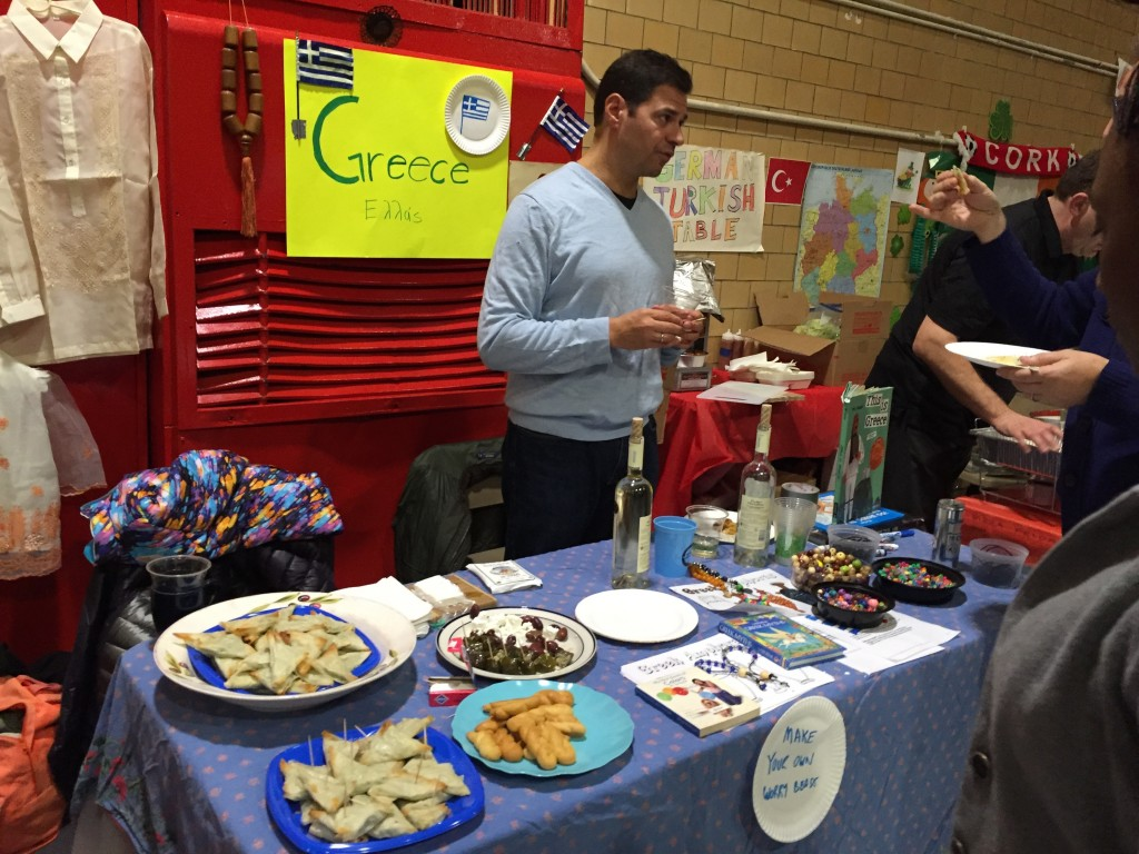 Spanakopita, greek wine, feta cheese and other goodies were at Greek table